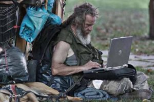 56homeless-man-with-laptop